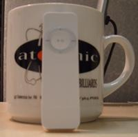ipod shuffle next to coffee cup